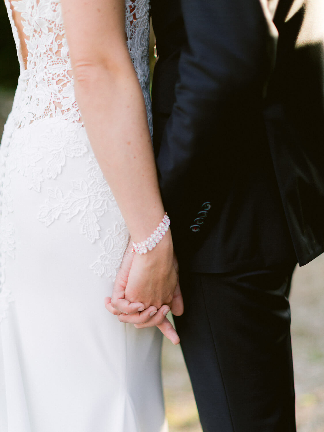 wedding couple hand in hand close up by Portugal Wedding Photographer