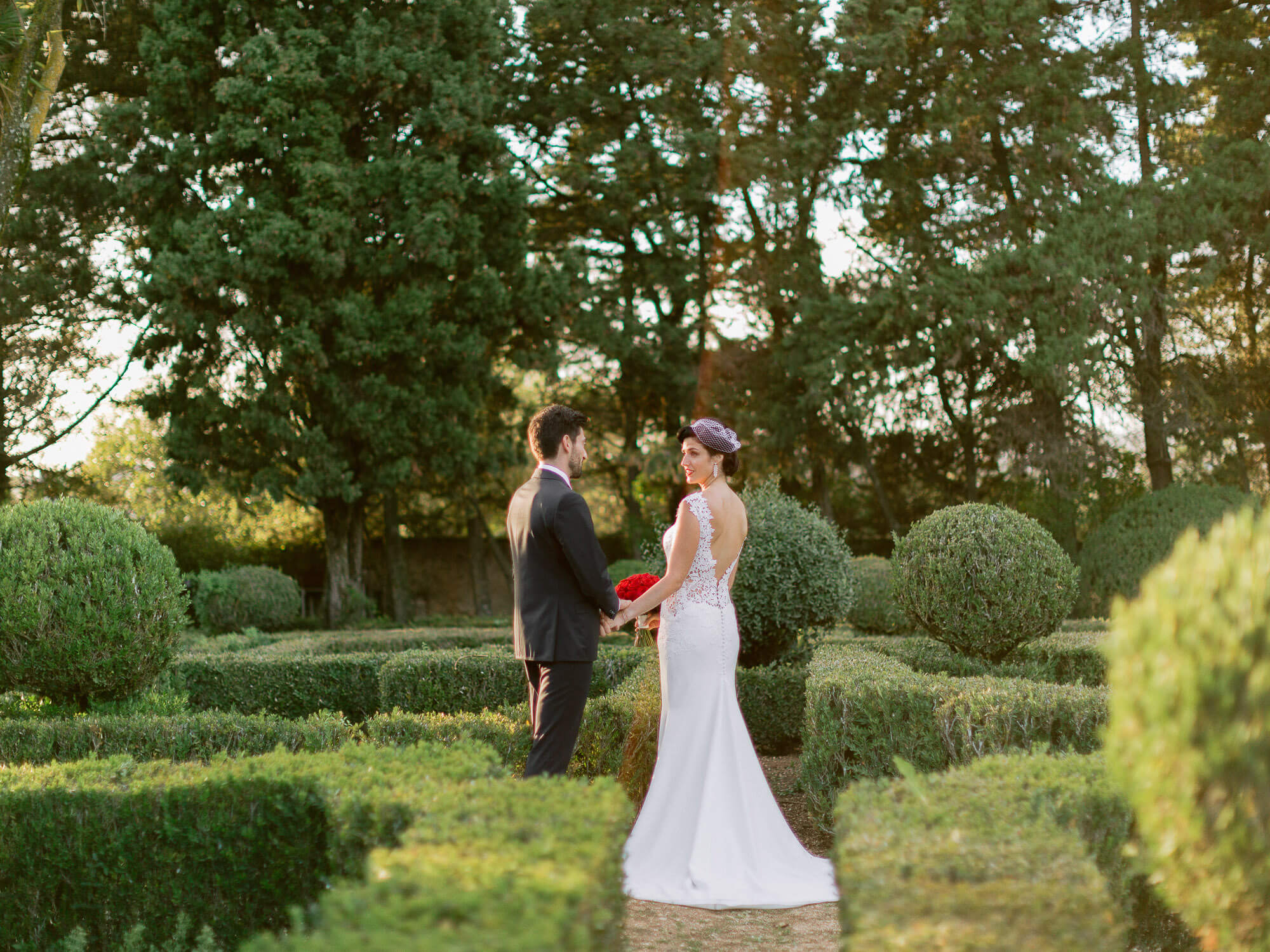 bride and groom romantic portrait on a french garden by Portugal Wedding Photographer