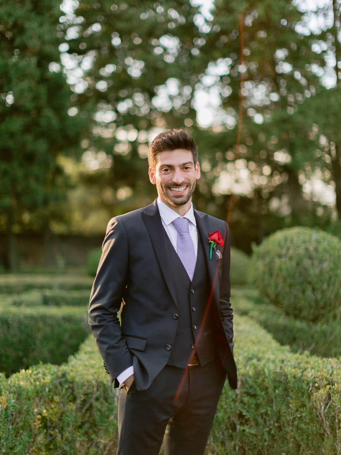groom portrait on a french garden by Portugal Wedding Photographer
