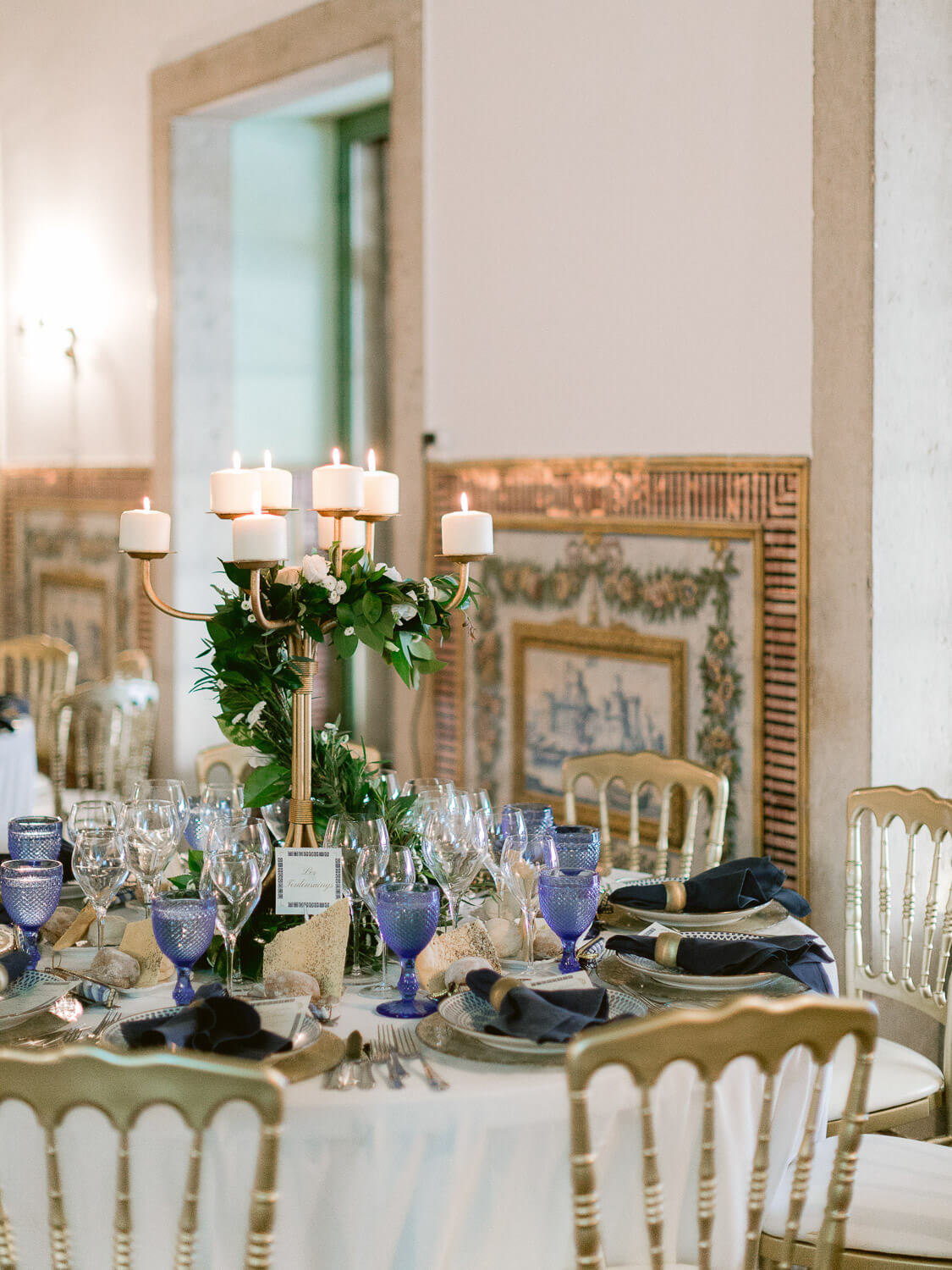 wedding reception tables with Portuguese wall tiles background by Portugal Wedding Photographer