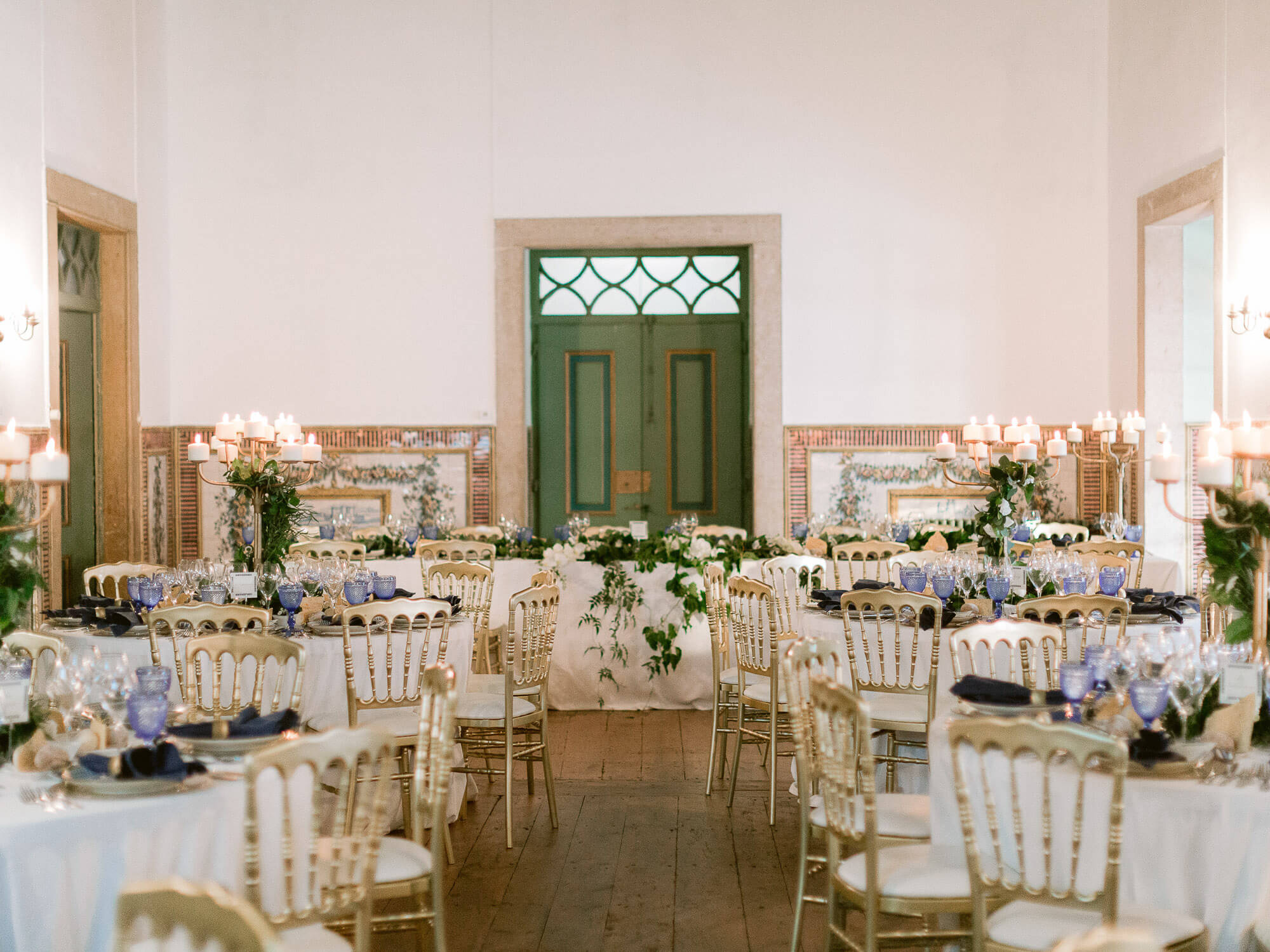 wedding reception hall with tables decorated in blue hues by Portugal Wedding Photographer