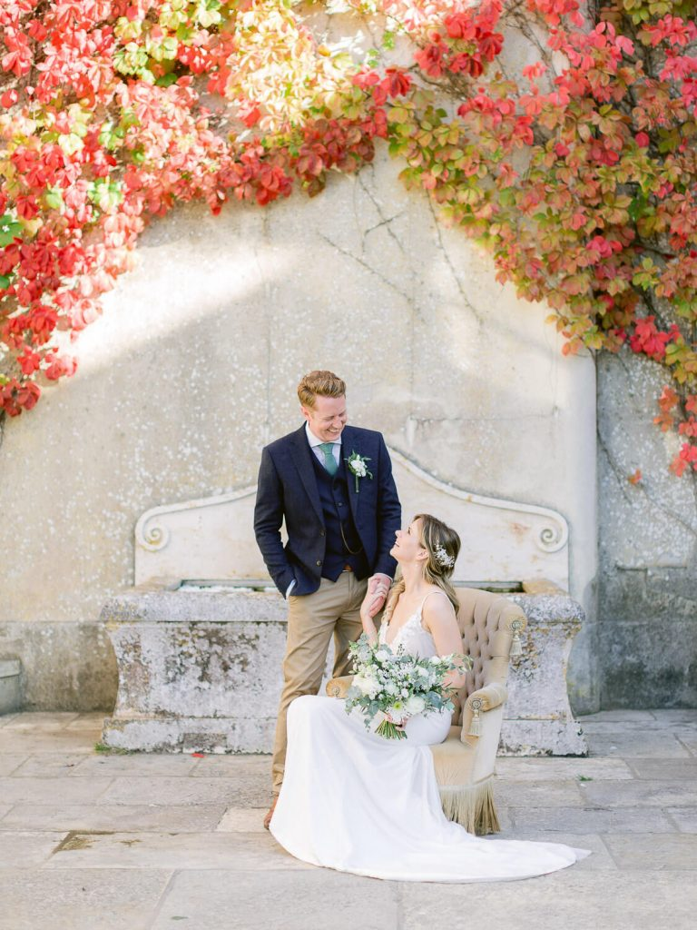 Bride and Groom portrait with Red blooming bougainvillaea backdrop, Sintra Wedding by Portugal Wedding Photographer