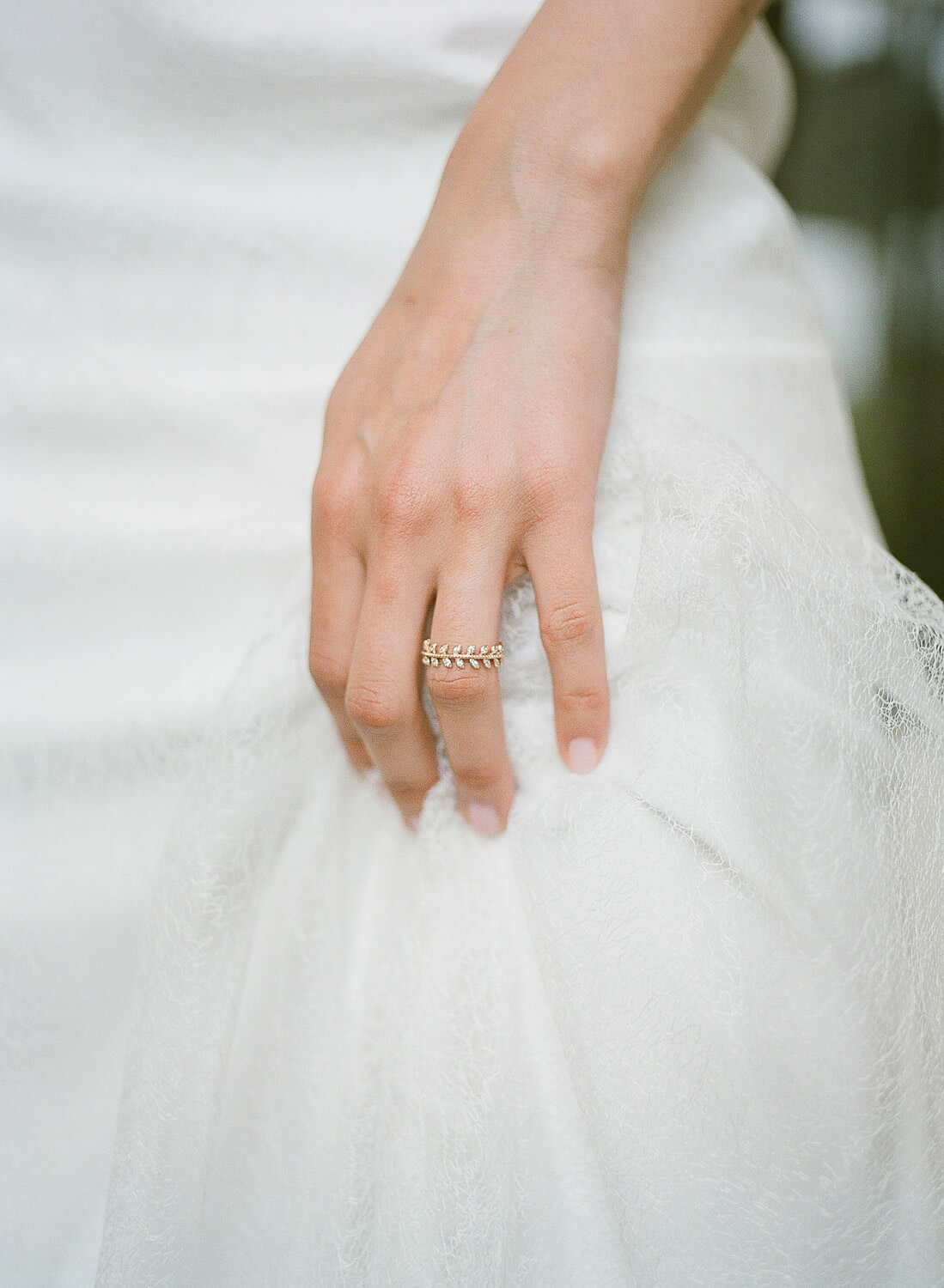 bride's hand with gold leaves ring detail by Portugal Wedding Photographer