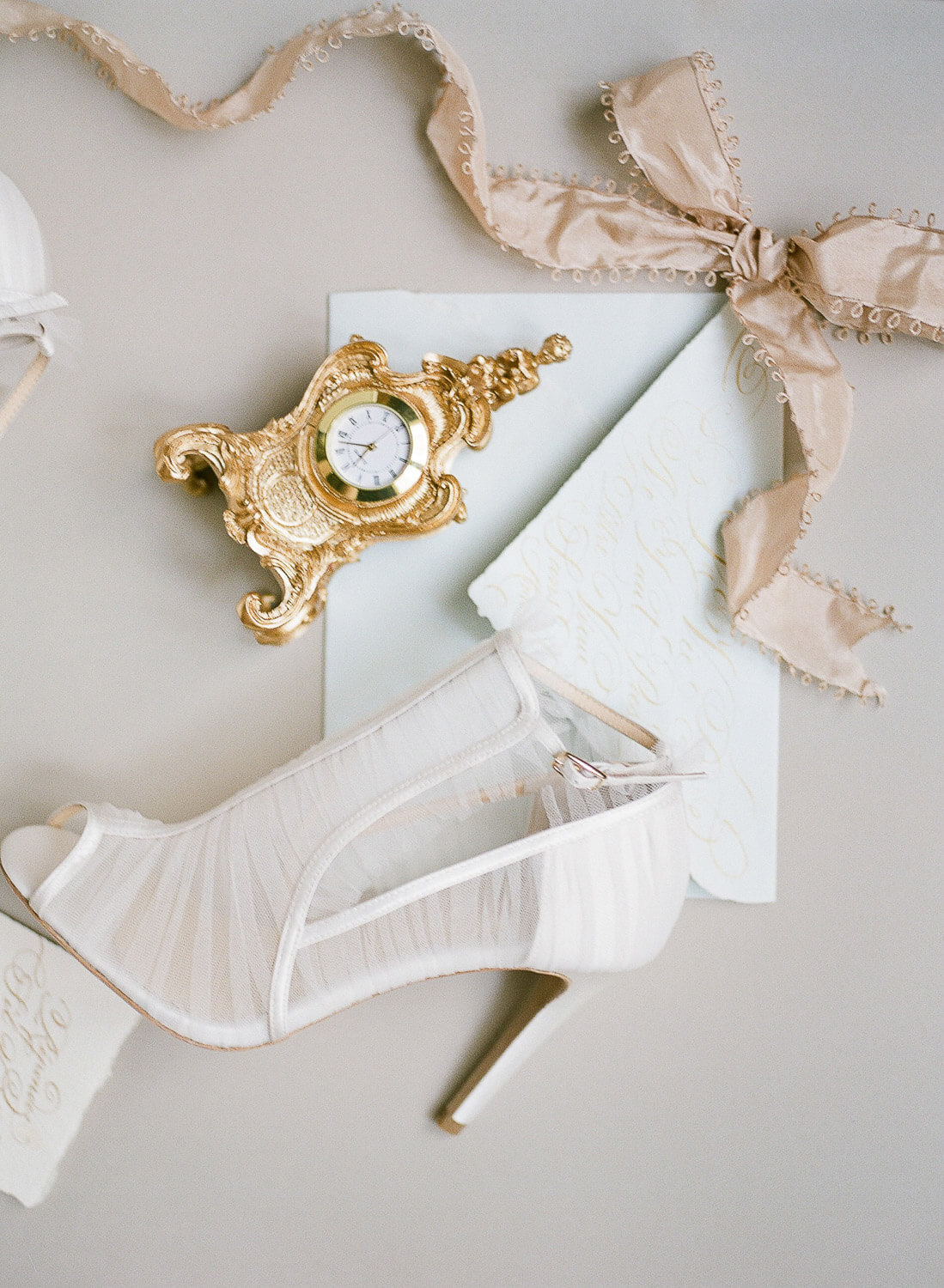 wedding editorial flat lay with bridal tule sandals, golden ribbon and vintage clock by Portugal Wedding Photographer