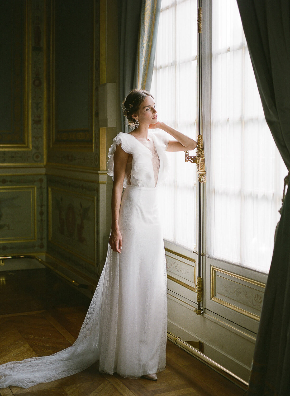 editorial bride portrait leaning over window door at Paris Palace by Portugal Wedding Photographer