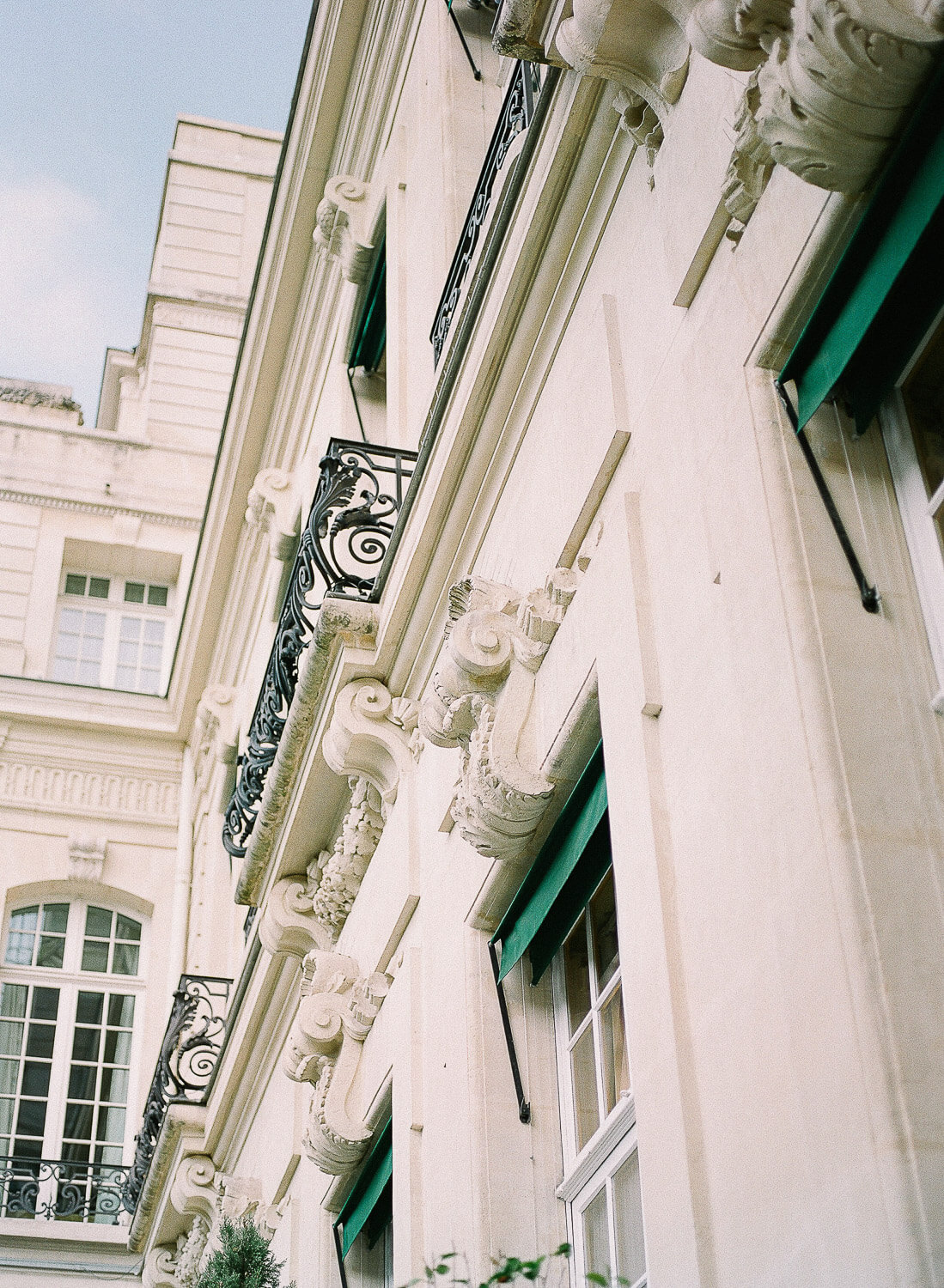 Paris Palace facade with green awnings by Portugal Wedding Photographer