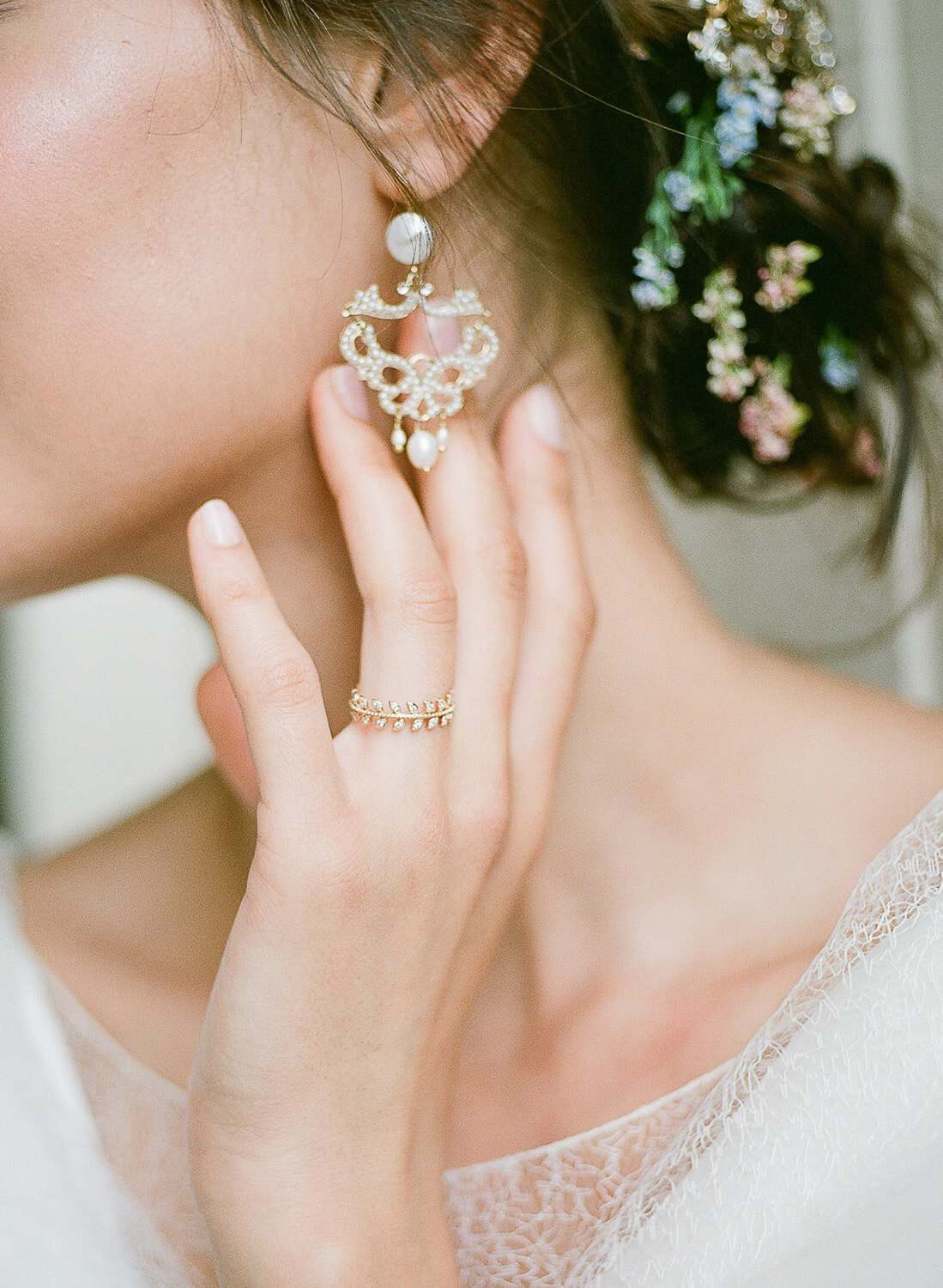 Bride's portrait detail of earring and ring by Portugal Wedding Photographer