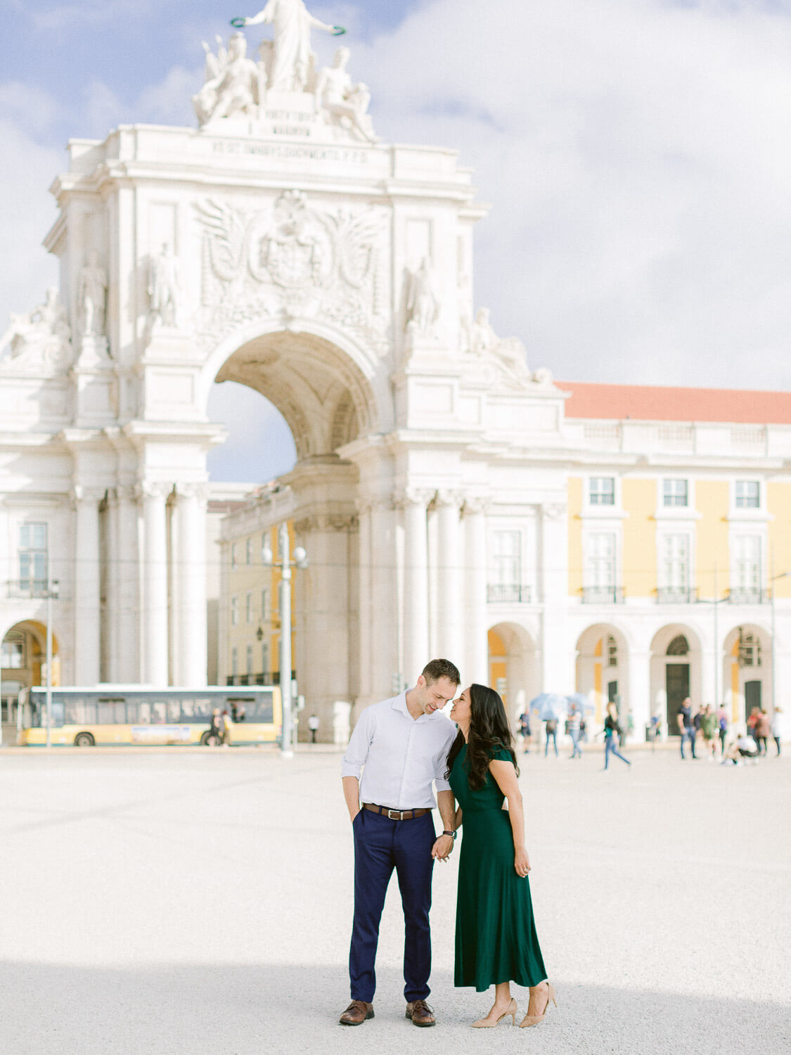 Romantic couple in front of Arco da Rua Augusta, Lisbon landmark triumphal arch by Portugal Wedding Photographer