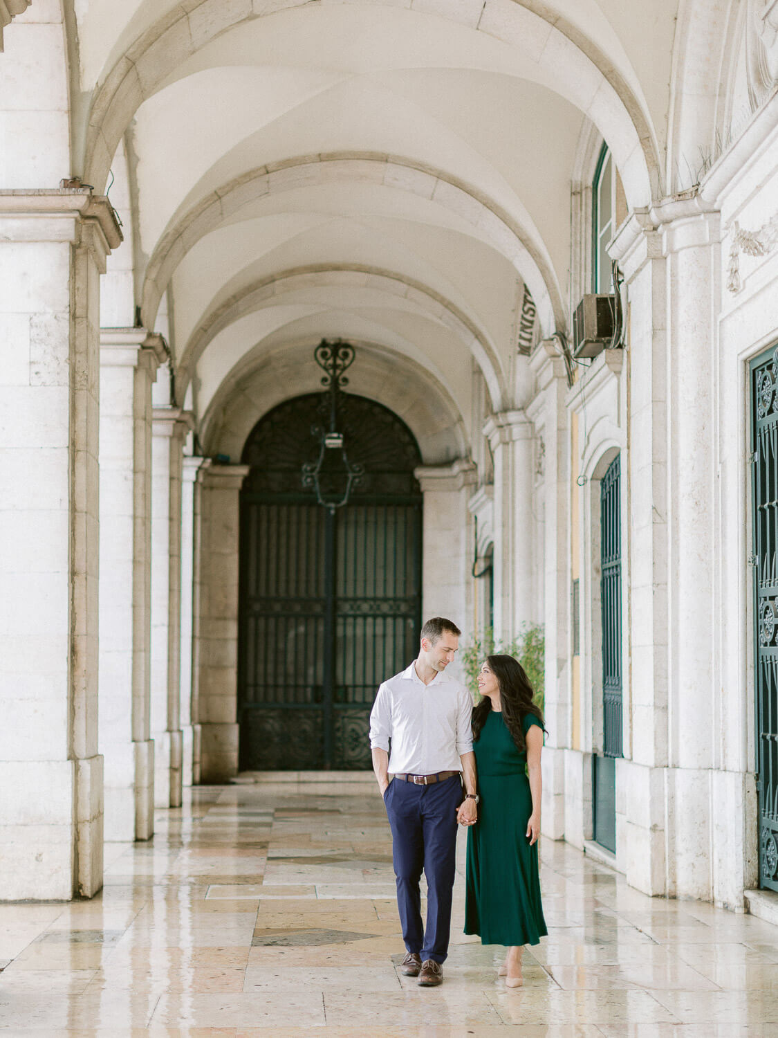 couple walking hand in hand romantically in Lisbon by Portugal Wedding Photographer