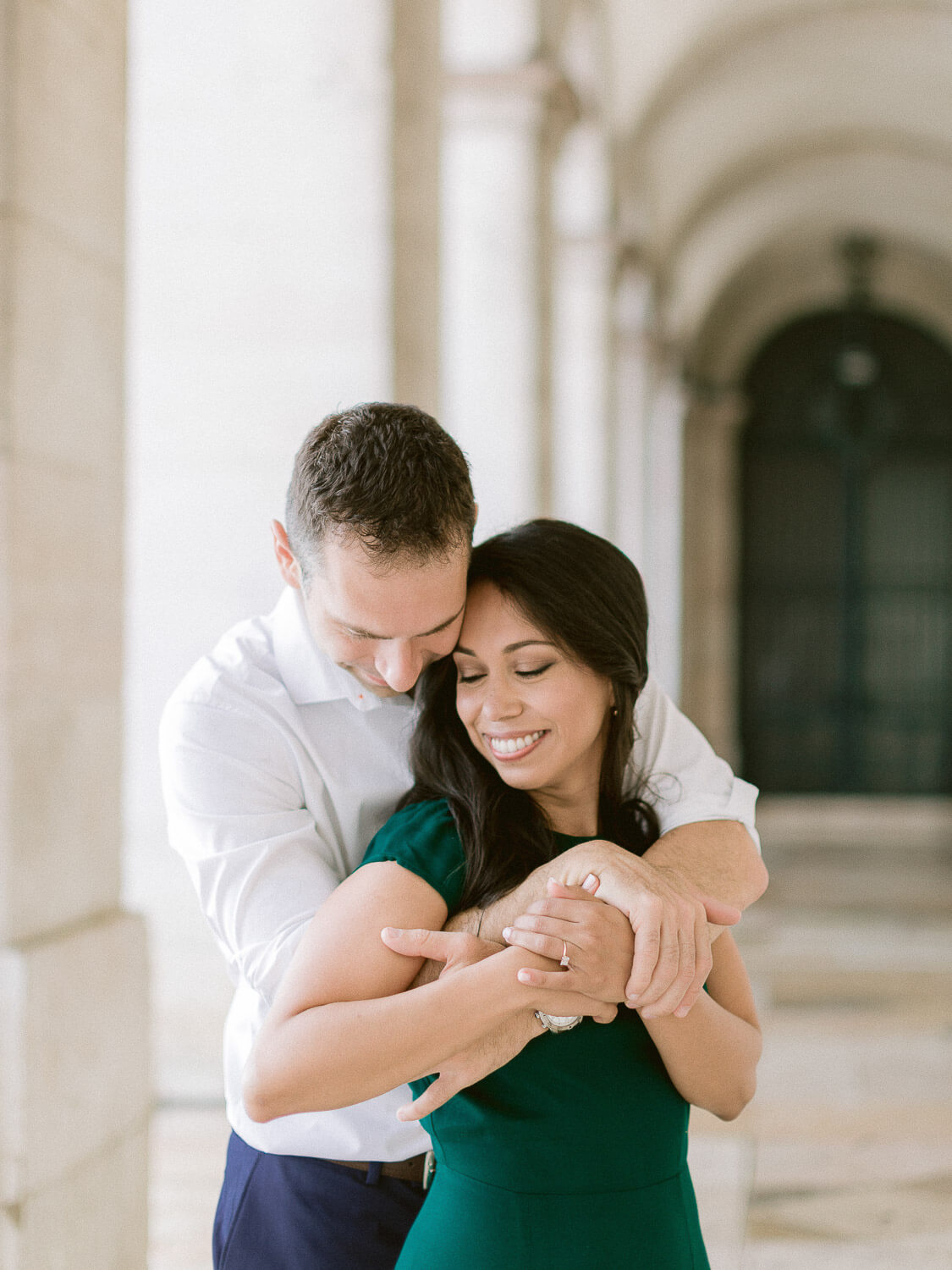 a couple's warm, loving embrace during an engagement session in Lisbon by Portugal Wedding Photographer