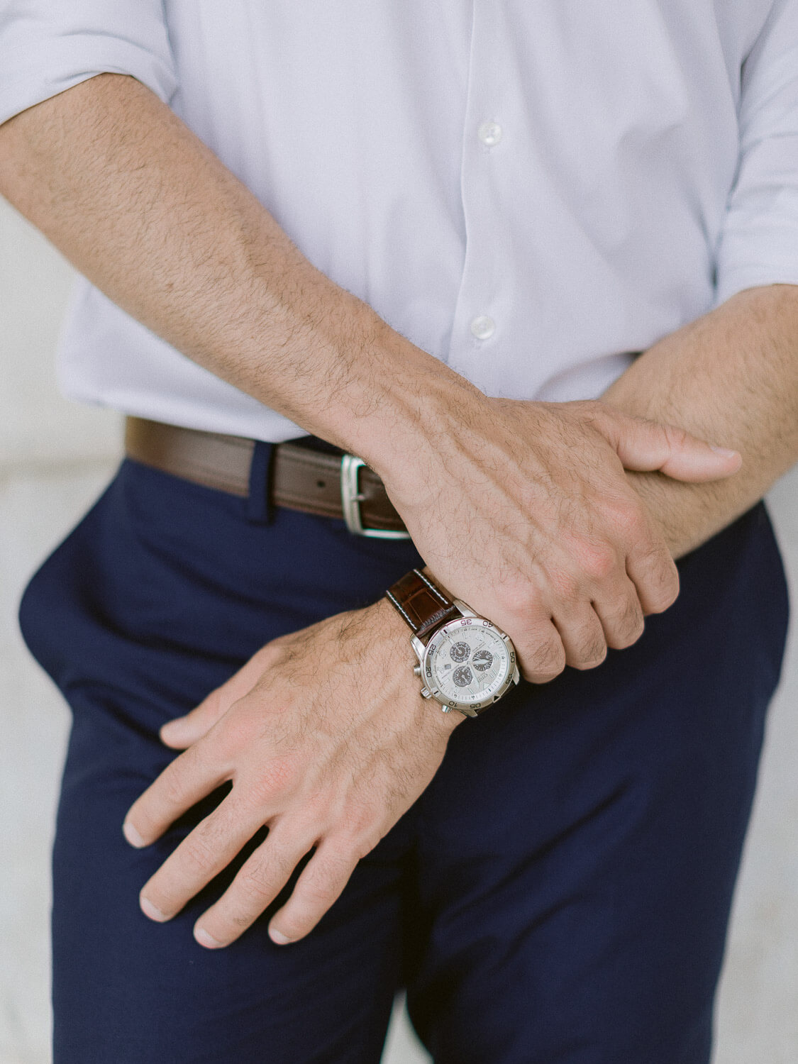 gentleman hand and watch detail during engagement session in Lisbon by Portugal Wedding Photographer