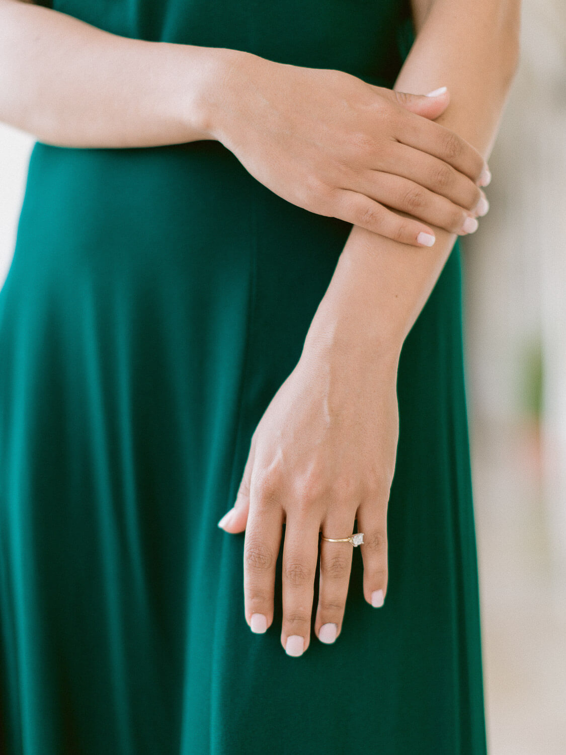 Engagement ring detail over emerald green dress during engagement in Lisbon by Portugal Wedding Photographer