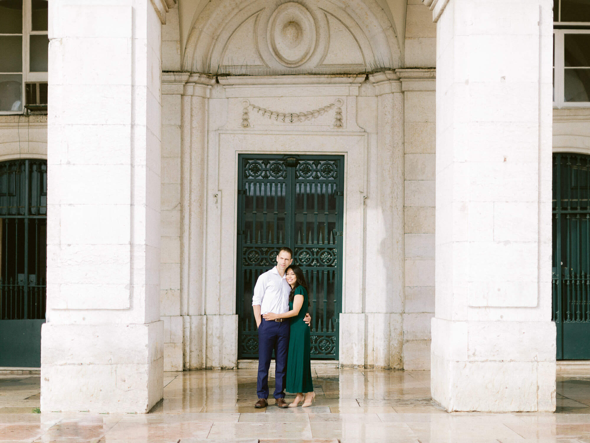 couple romantically holding in front of typical Lisbon facade by Portugal Wedding Photographer