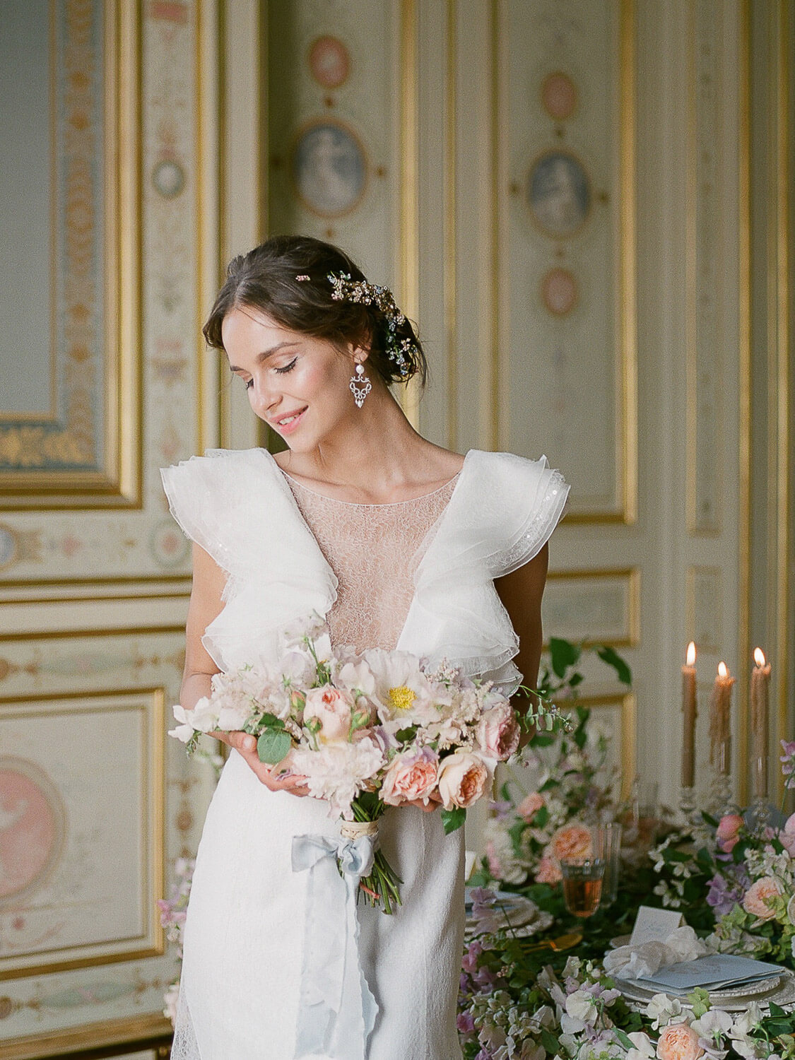 Fashionable bride holding bridal bouquet at Paris Palace by Portugal Wedding Photographer