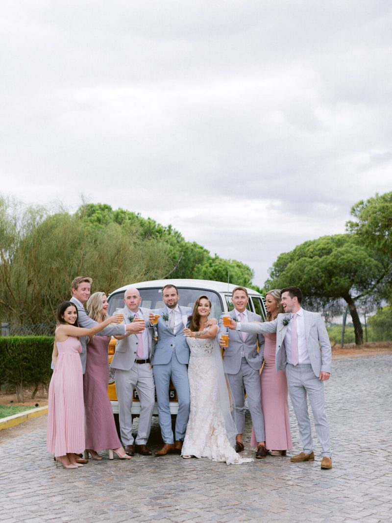 bride, groom, bridesmaids and groomsmen wedding toast by Portugal Wedding Photographer