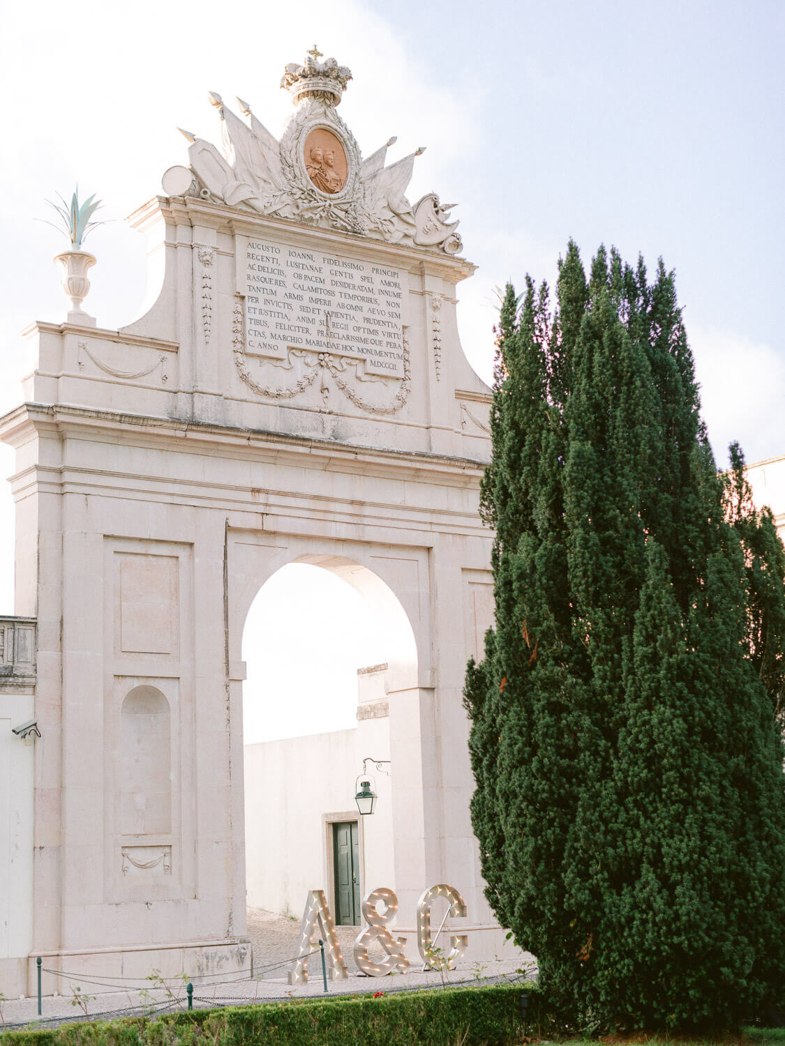 Palacio de Seteais triumphal Arch with wedding couple's initials decor by Portugal Wedding Photographer