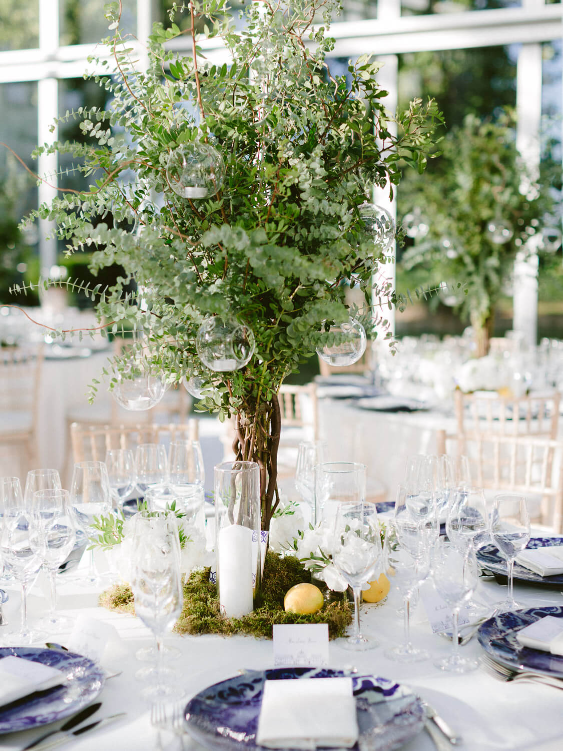 tall greenery reception centrepieces for a wedding reception in Seteais Palace Sintra by Portugal Wedding Photographer