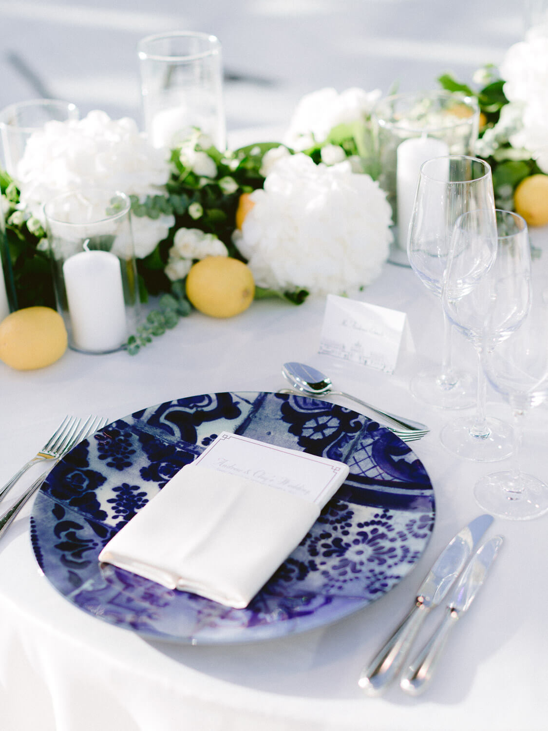 wedding reception table with blue Azulejos inspired dinnerware in Seteais Palace Sintra by Portugal Wedding Photographer
