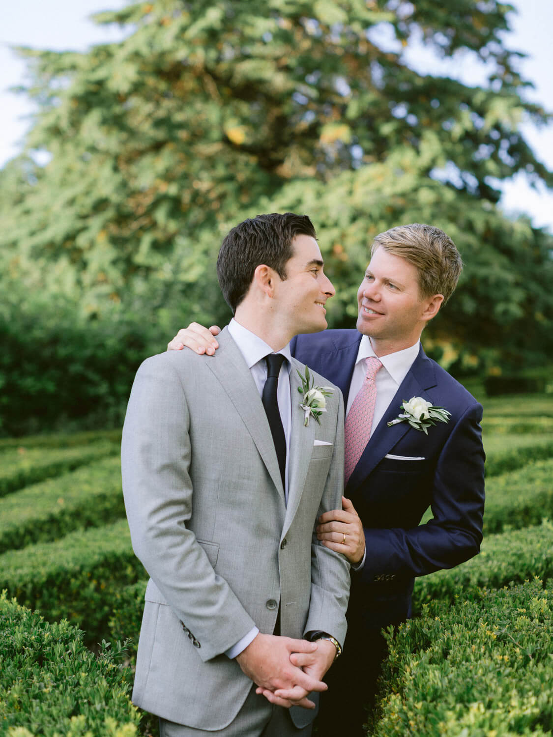 joyful newlyweds posing in Seteais Palace French garden by Portugal Wedding Photographer