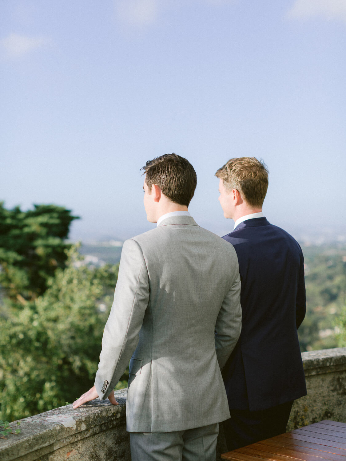 newlyweds gazing the view from Seteais Palace veranda by Portugal Wedding Photographer