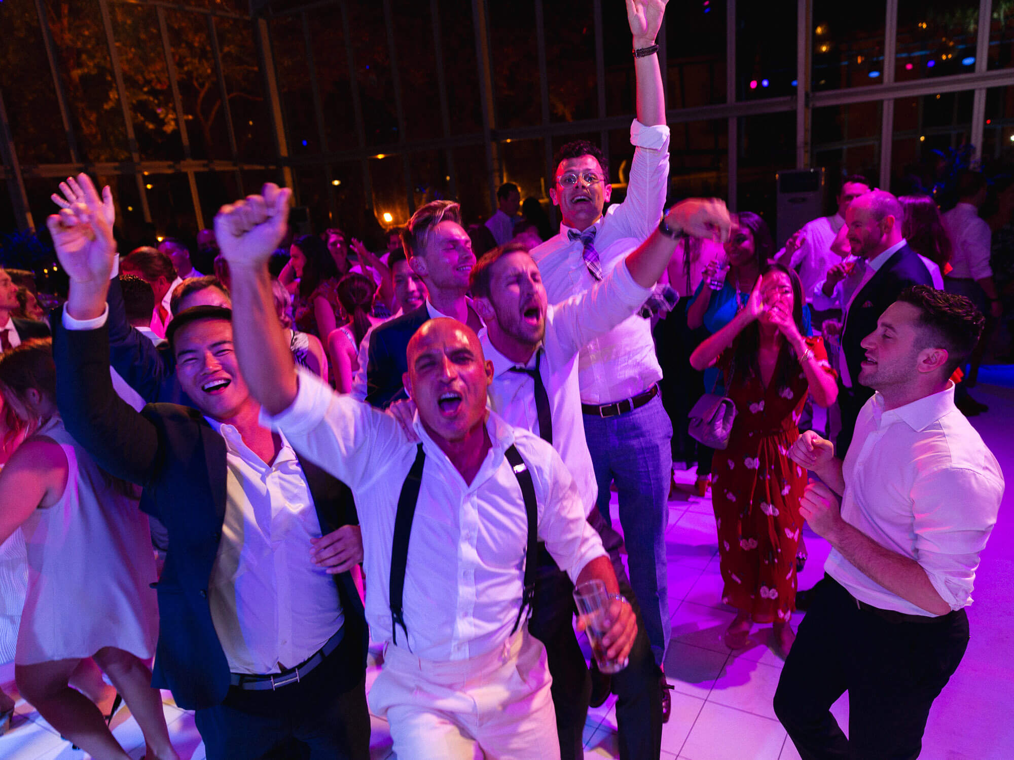 cheering guests on the dance floor by Portugal Wedding Photographer in Seteais Palace Sintra