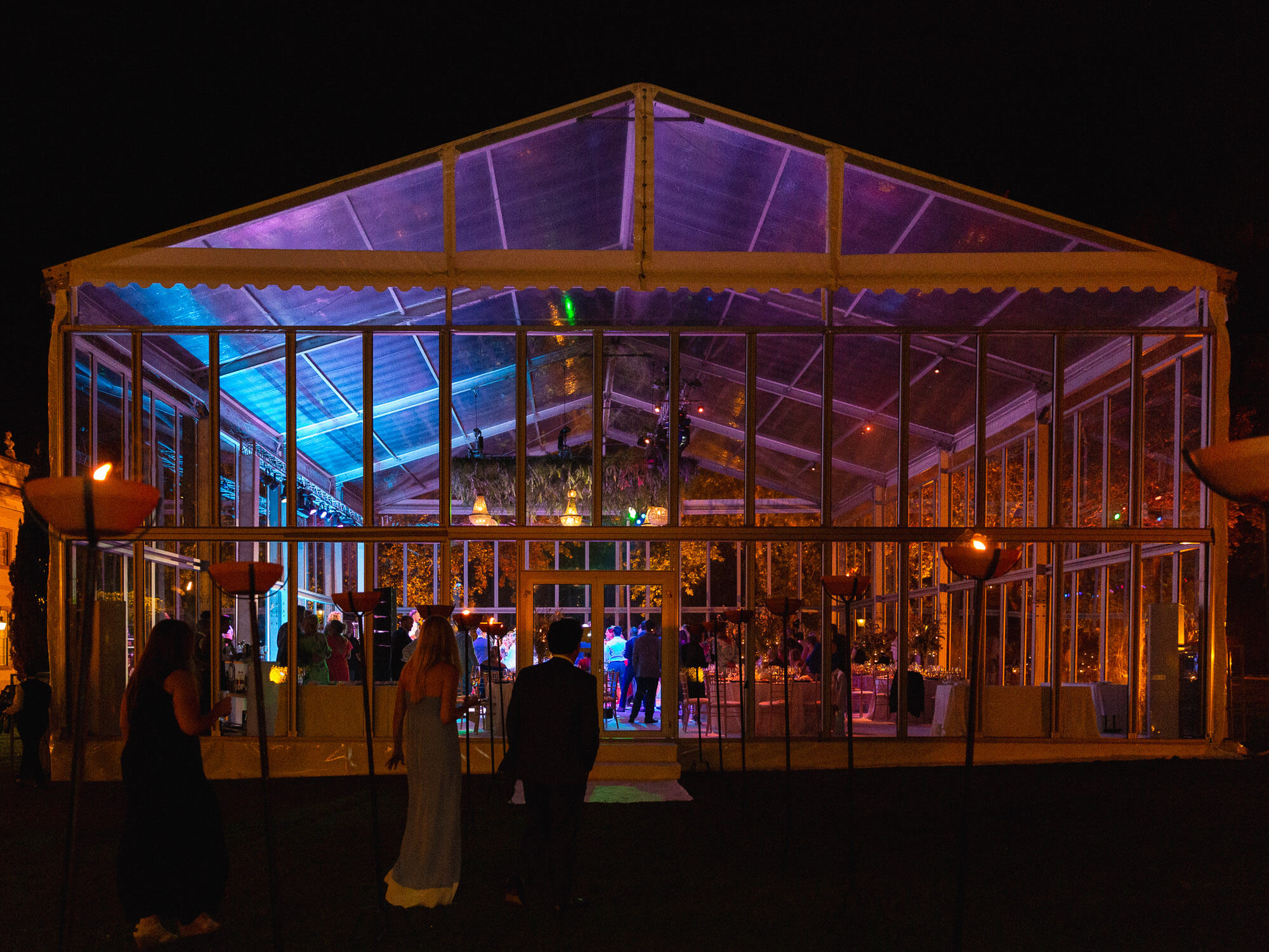 transparent wedding reception tent by night by Portugal Wedding Photographer