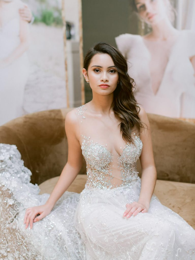 Model in bridal gown sitting