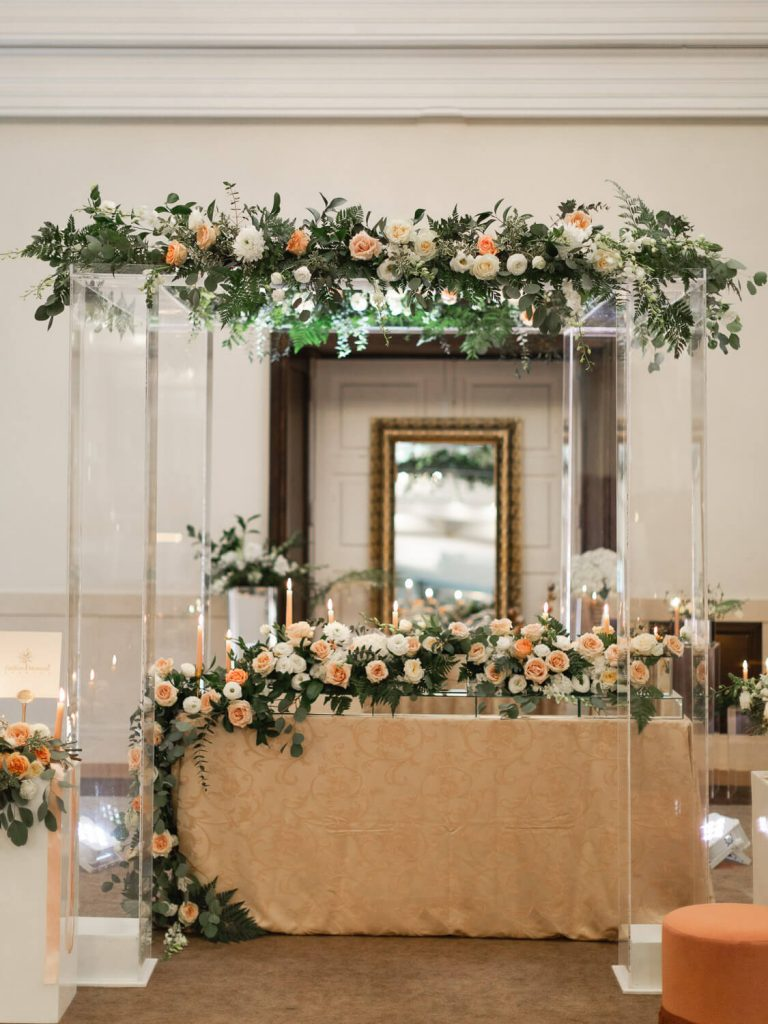 Wedding arch decorated with flowers and candles