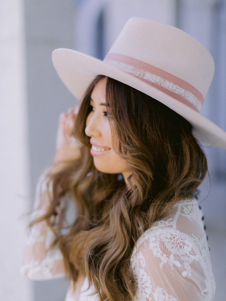 Stylish bridal inspiration photo with bride wearing a designer hat